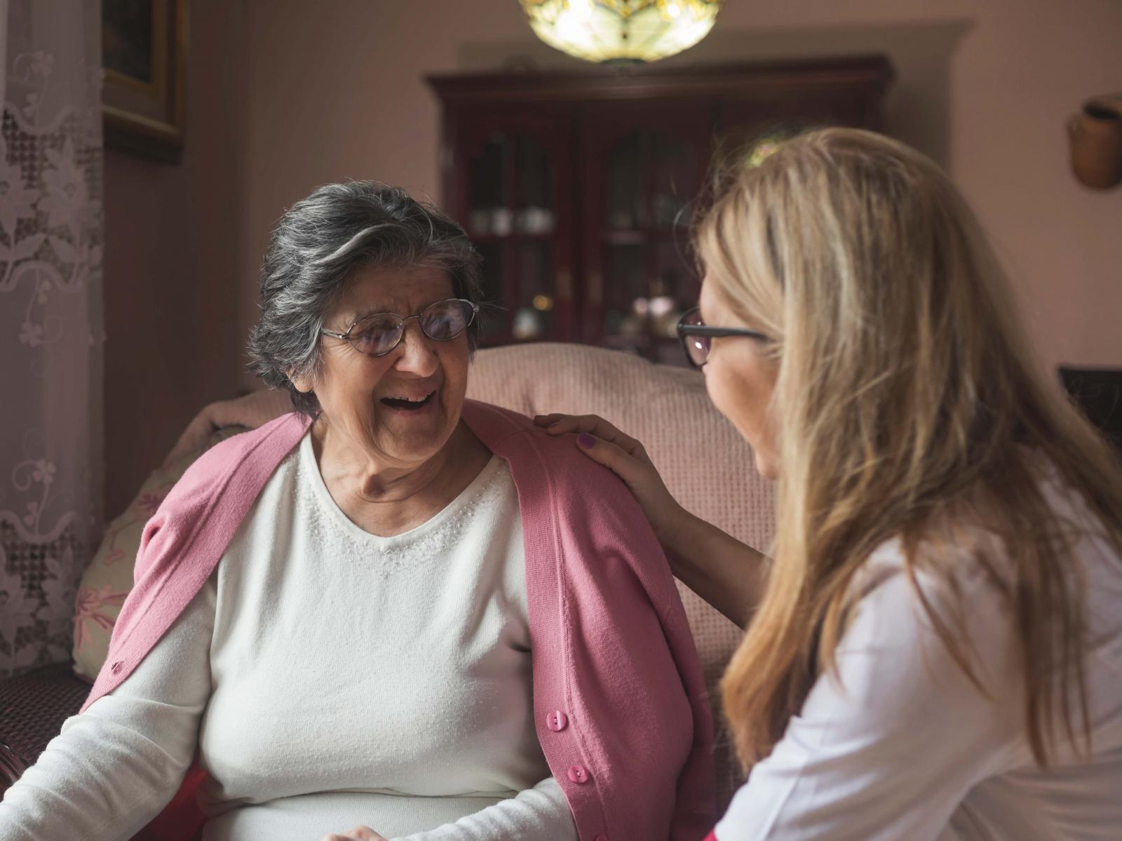 Carer and resident in a home