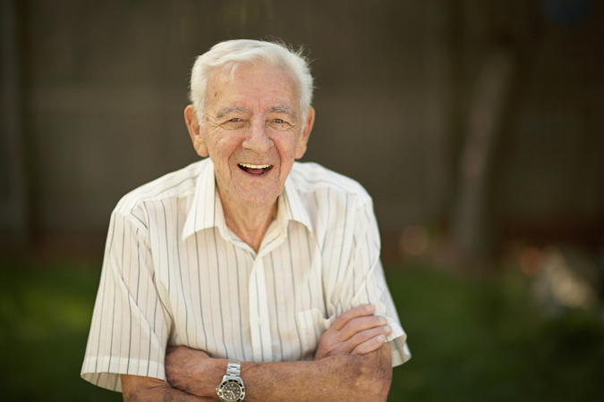 Smiling older man with folded arms