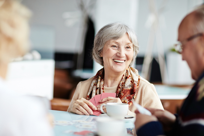 Older adults chatting and smiling