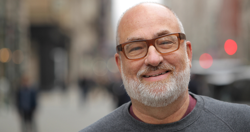Man with beard and glasses smiling