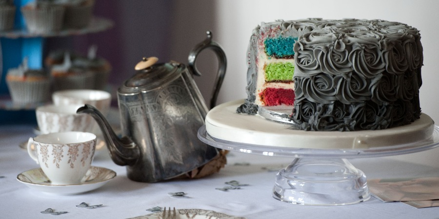 Image of grey cake with rainbow centre