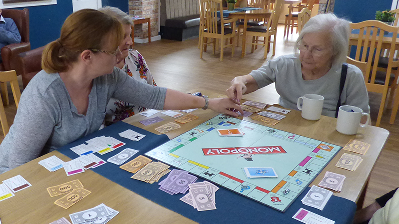 People playing Monopoly in Adams House