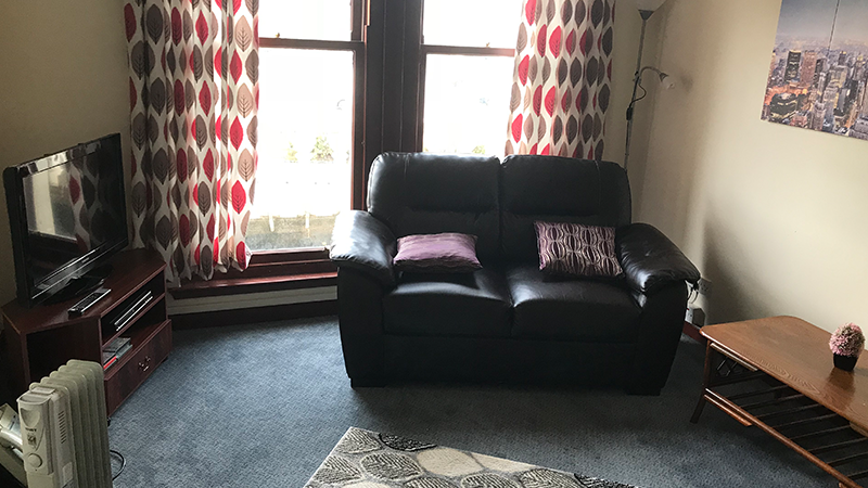 An inviting room with a 2 seat sofa