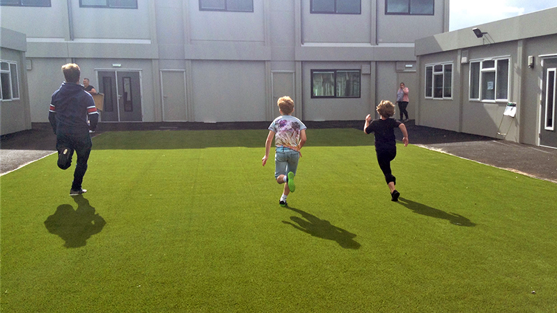Children running on grass