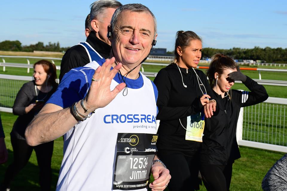 CrossReach supporter at finish of 10k race