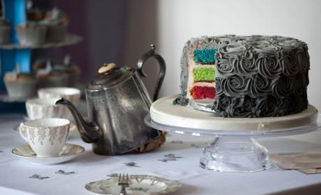Multi-coloured cake with grey icing