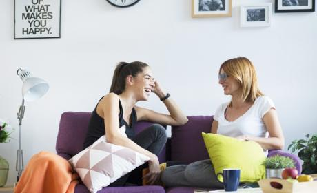 Two women chatting on a sofa